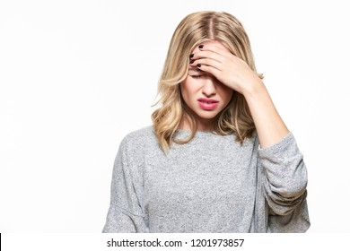 Young Woman Having Headache. Stressed Exhausted Young Woman Having Strong Tension Headache. Waist up Portrait Of Beautiful Woman Suffering From Migraine, Feeling Pressure And Stress.