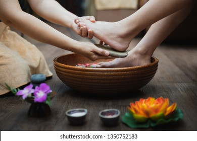 Young woman having her feet scrubbed in beauty salon, Female feet at spa pedicure procedure, Spa foot massage, Massage of woman's foot in spa salon, Beauty treatment concept