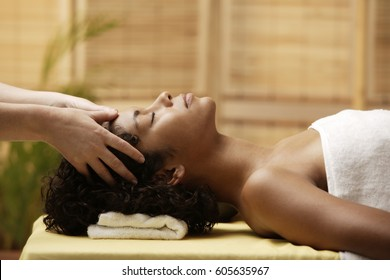 Young woman having her head massaged