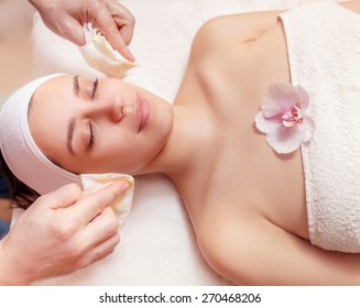 young woman having a honey facial at spa salon
