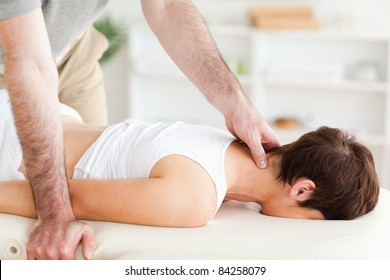 A young woman is having a massage