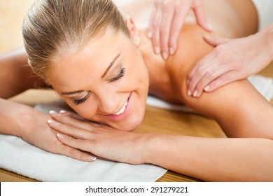 Young woman having massage on spa treatment