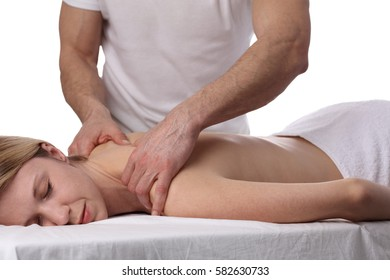 Young woman having massage. Relaxation, body care treatment, spa, wellness concept
