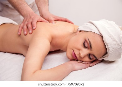 Young woman is having a massage in salon