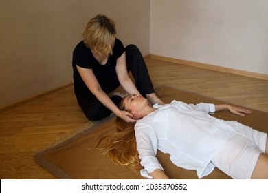 Young woman having massage treatment in health centre