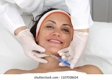 Young Woman Having Neck Fillers Treatment at Beauty Clinic