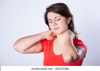 Young woman having neck pain after night