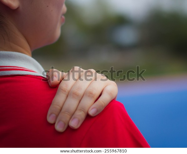 Young woman having pain in the back and neck,Pain in back
