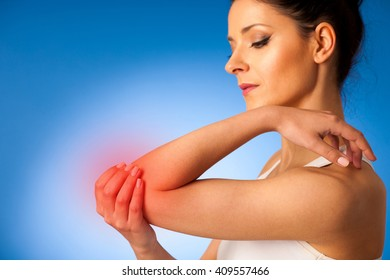 young woman having pain in injured elbow