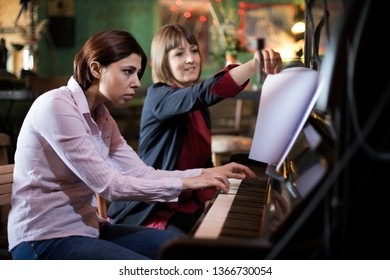 young woman having a piano lesson