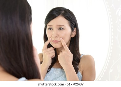 Young woman having skin problems