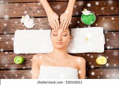 Young woman having spa procedures, xmas concept.