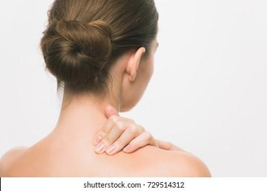 Young woman having stiff shoulders.