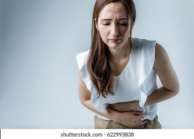 young woman having a stomachache