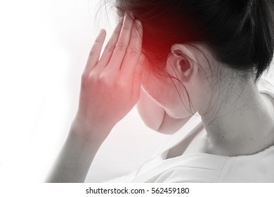 Young woman having strong headache and touch head isolated white background, concept of health care lifestyle. focus from rear body.