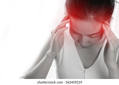 Young woman having strong headache and touch head isolated white background, concept of health care lifestyle. focus from top view.
