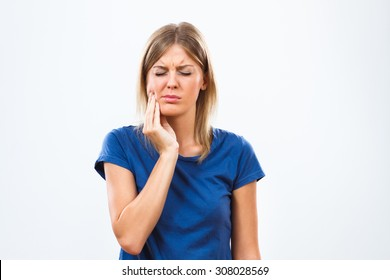 Young woman is having toothache.Toothache