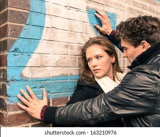 Young woman having trouble with a man