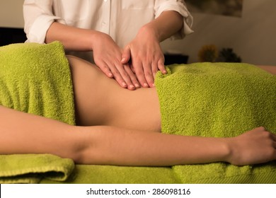 Young woman having a waist massage at the spa