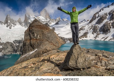 Young woman a head of amazing Fitz Roy mountain in Patagonia, Argentina
