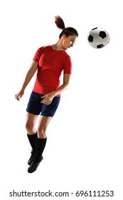 Young woman heading soccer ball isolated over white background