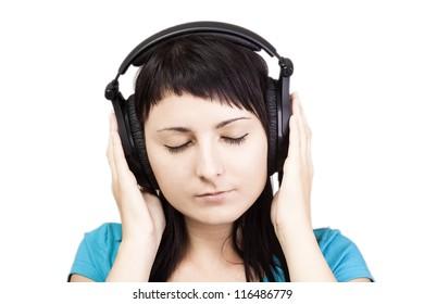 Young woman with headphones, enjoying nice music.
