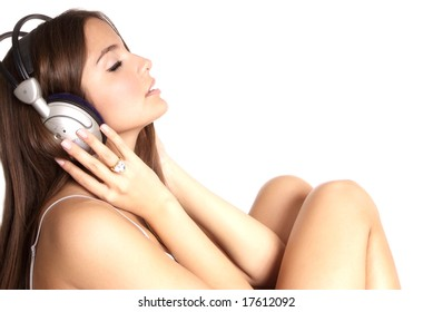 young woman with headphones listen to music
