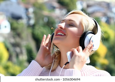 Young woman with headphones listening to music.