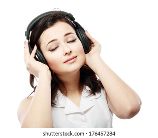 Young woman with headphones listening music close up face