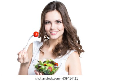 Young woman with healthy salad. Isolated on white. Healthy lifestyle.