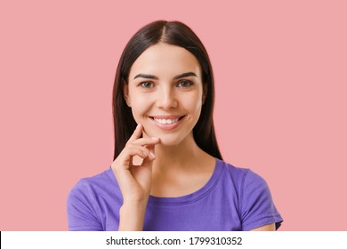 Young woman with healthy teeth on color background
