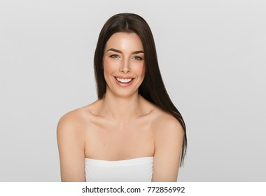 Young woman with healthy teeth smile natural portrait, beautiful female girl with healthy skin and long brunette hair
