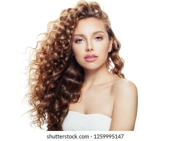 Young woman with healthy wavy hair and clear skin isolated on white