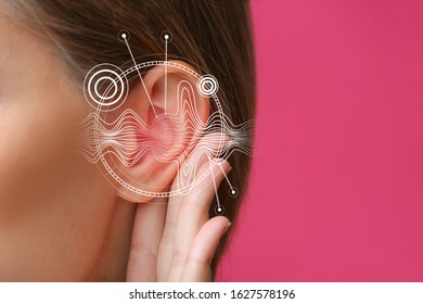 Young woman with hearing problem on color background, closeup