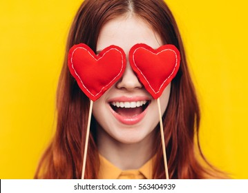 Young woman with hearts, eyes hearts, hearts for the holiday