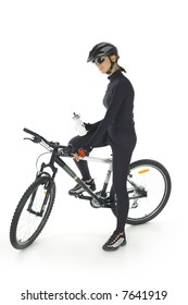 Young woman with helmet and sunglasses, sitting on mountain bike. White background. Whole body, side view