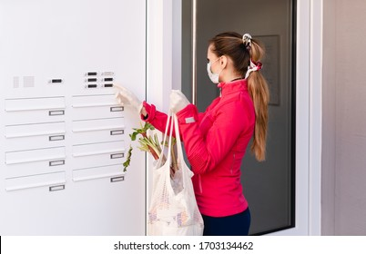 Young woman helping neighbors by shopping groceries for people in covid-19 quarantine