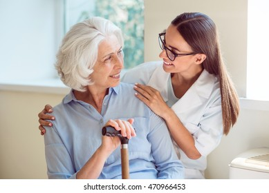 Young woman helping senior