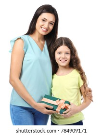 Young woman and her daughter with gift box on white background. Mother's day celebration