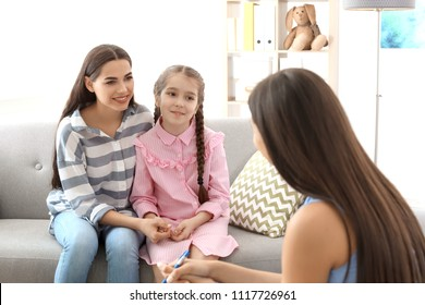 Young woman and her daughter having appointment with child psychologist in office
