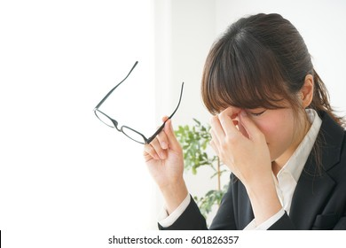 Young woman with her eye dry