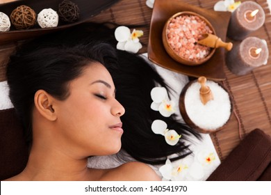 Young Woman With Her Eyes Closed Relaxing In A Spa