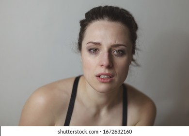 Young woman with her eyes red from crying and mascara smeared