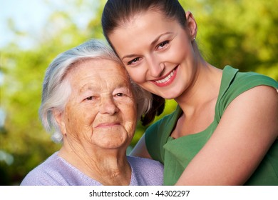 Young woman and her grandmother smiling