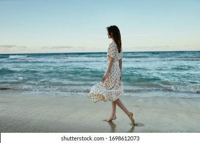 young woman with her hair outdoors model in summer dress