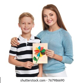 Young woman with her little son and greeting card for Mother's Day on white background