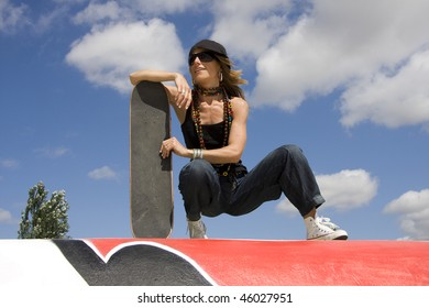 Young woman with her skate