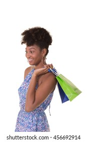Young woman in her twenties carrying shopping bags looking off camera