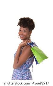 Young woman in her twenties carrying shopping bags