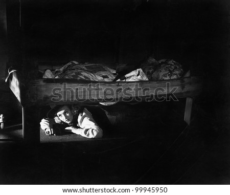 Young Woman Hiding Under Bed Stock Photo Edit Now 99945950